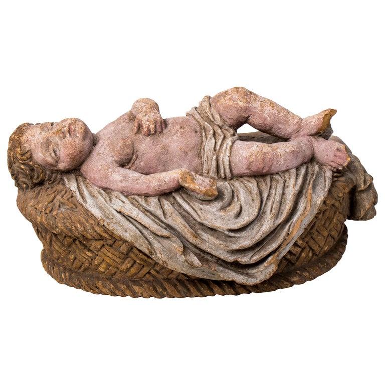 Niño Jesús de Terracota Pintado Acostado en la Cuna, España, de Finales del Siglo XVIII y Principios del XIX